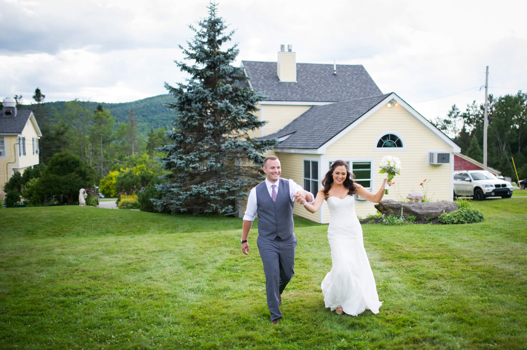 Bride and Groom in front of Red Clover Inn.
