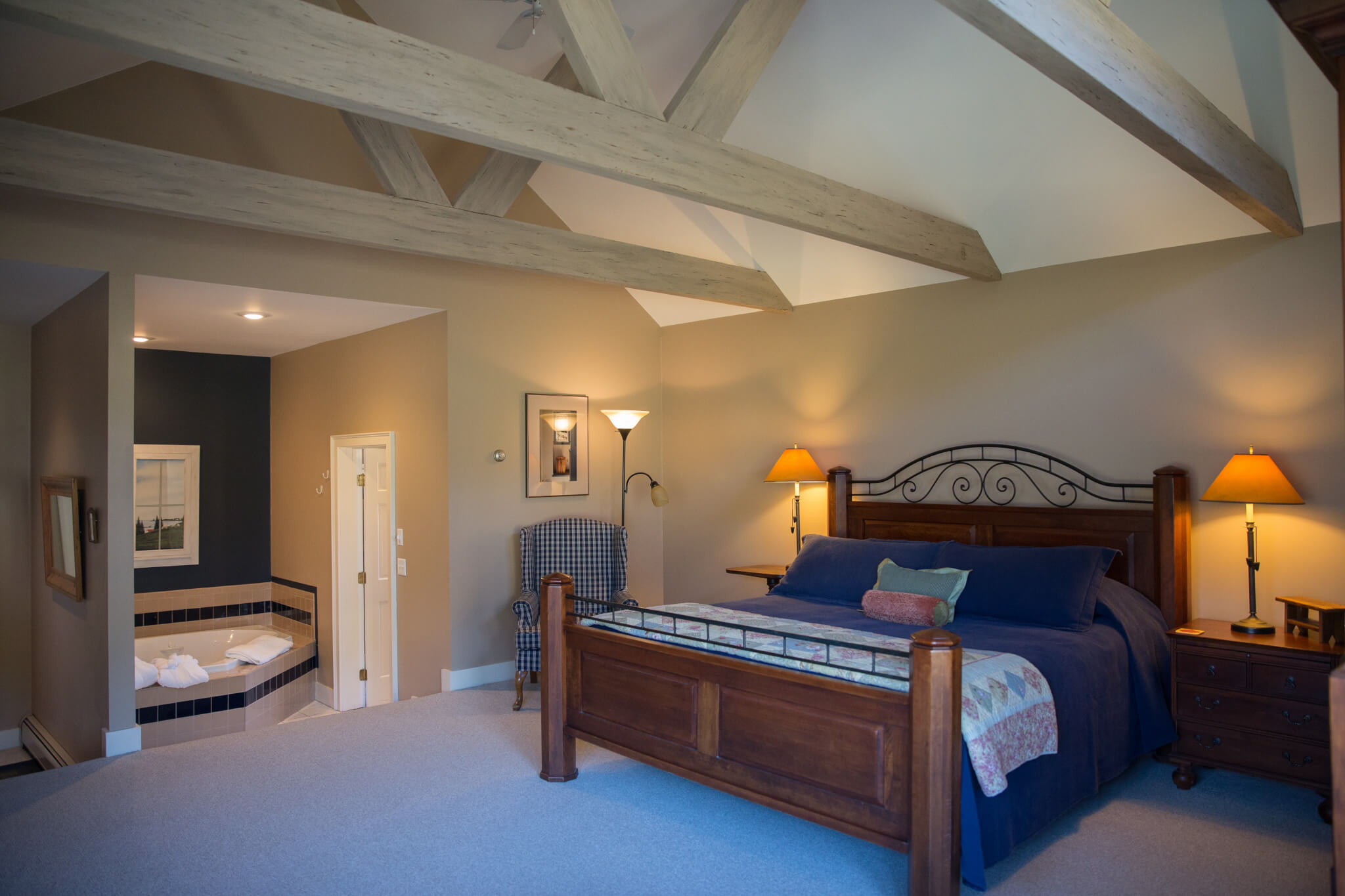 Ben Flint's room with king-sized bed, comfortable seating, and an in-room jetted tub.