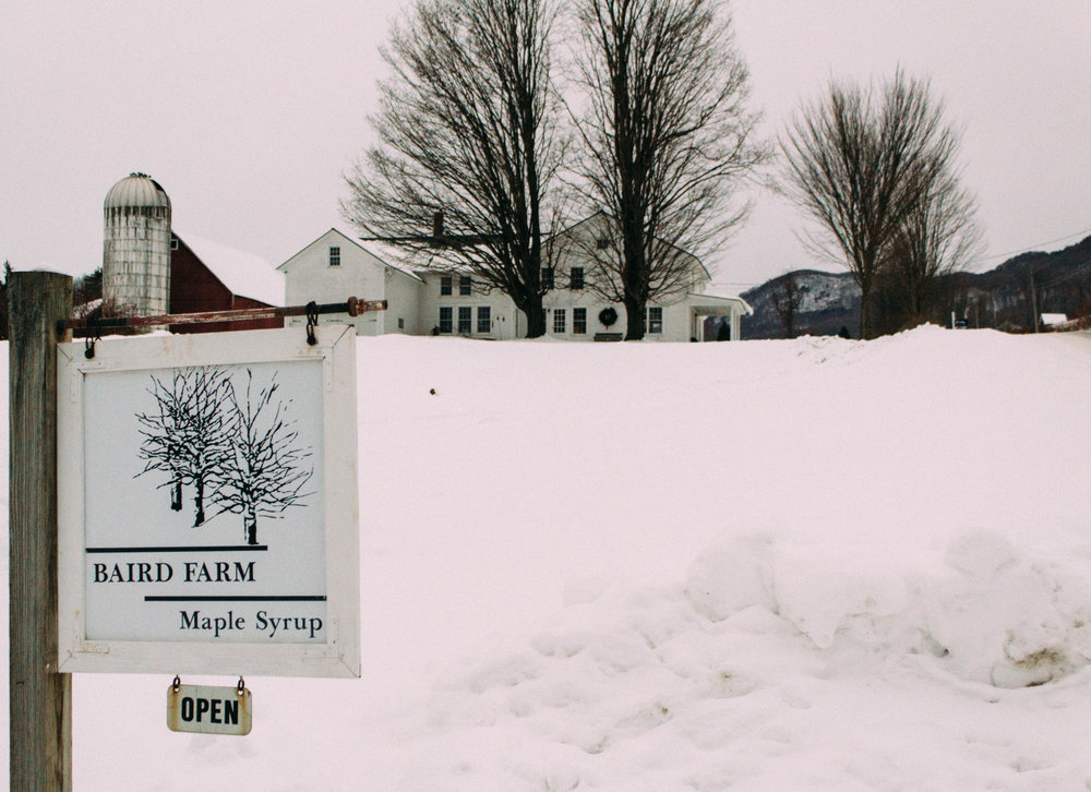 Baird Farm house and sign with snow