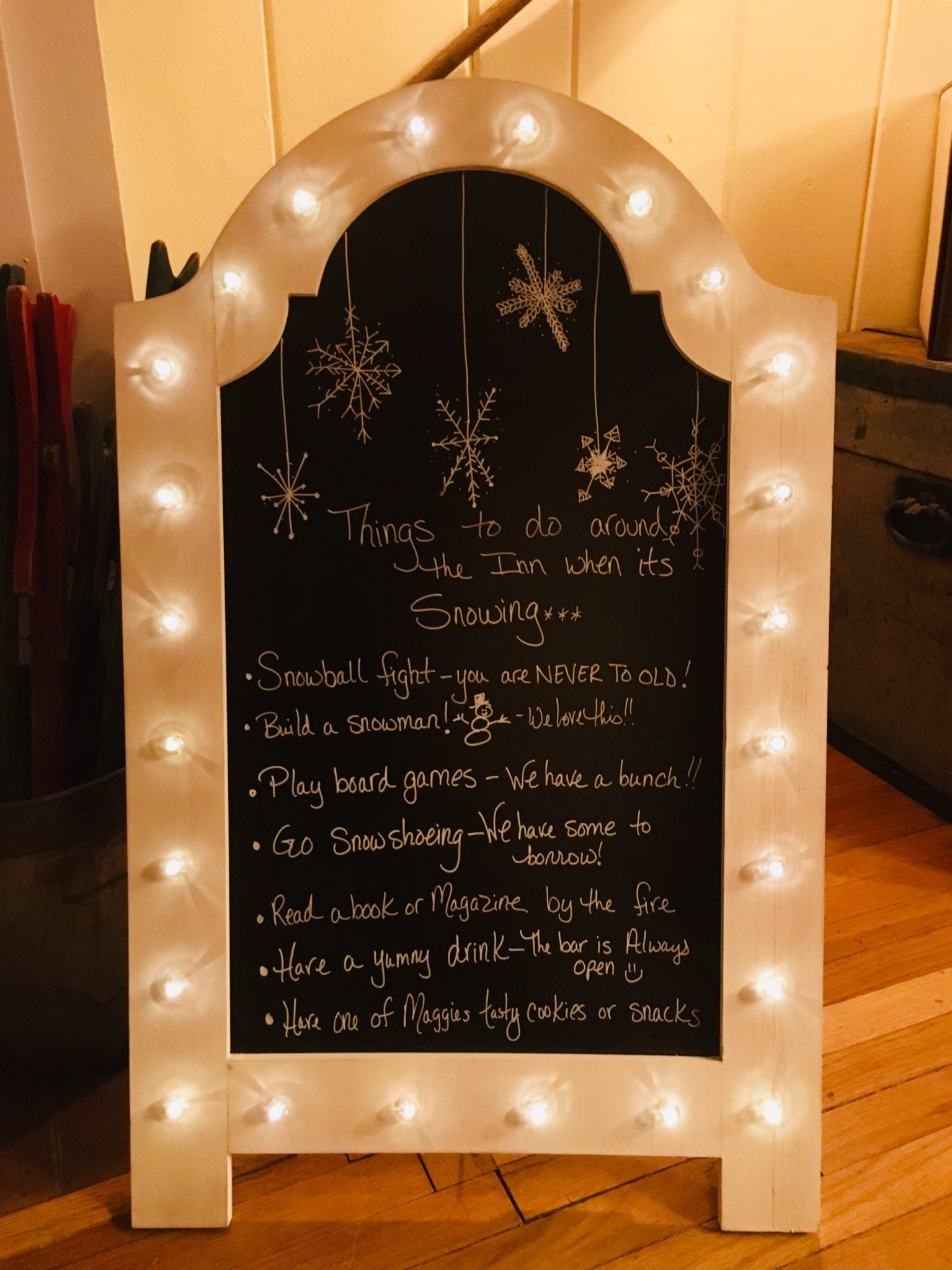chalkboard sign listing winter activities at the inn