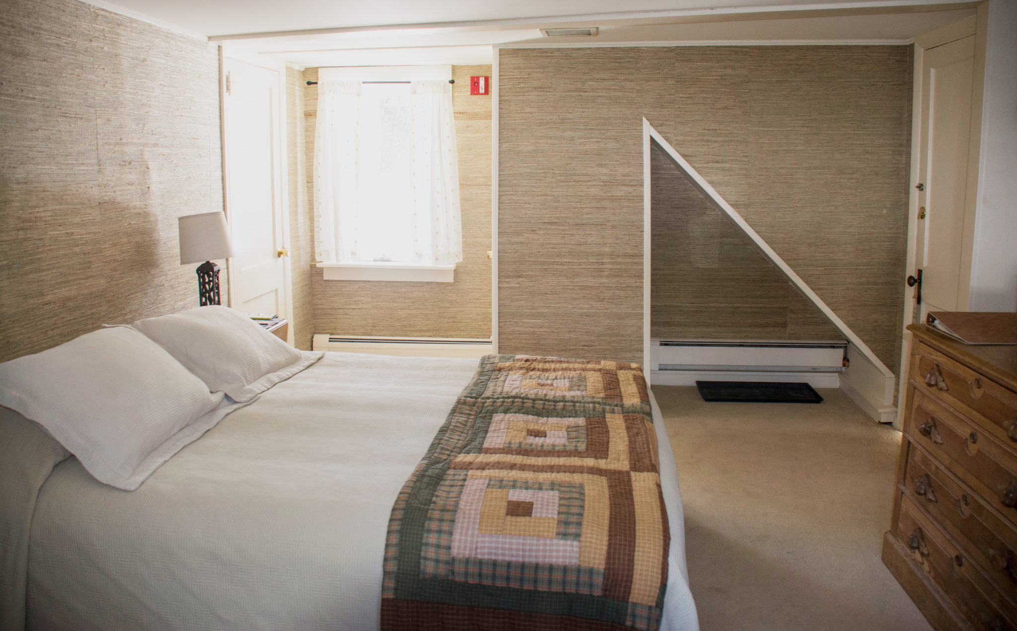 Bed with closet and window