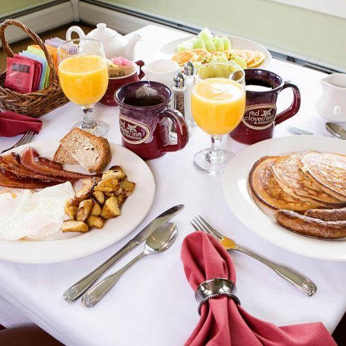 Pancakes with sausage links, eggs made to order, orange juice and coffee