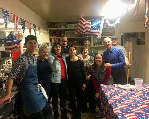 group of Red Clover Inn staff celebrating in kitchen